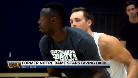 Former Notre Dame basketball players giving backpacks to local kids
